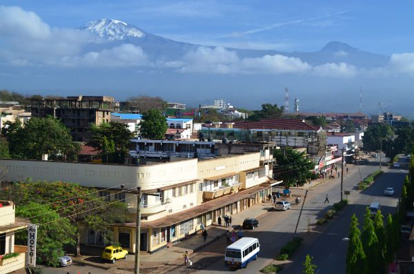 The twin peaks of Kilimanjaro, Kibo and Mawenzi, as seen from a hotel terrace overlooking the town of Moshi