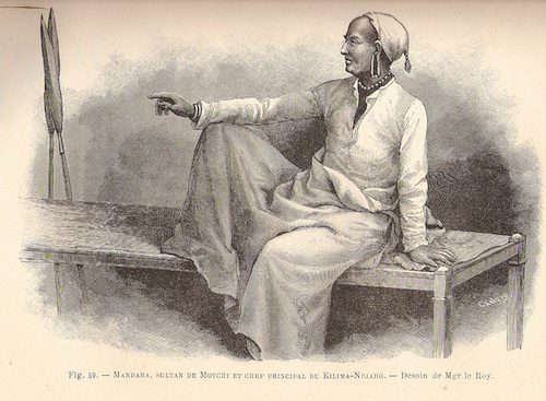 Drawing of Chief Mandara, seated on a low bed, wearing white cap and robes, a necklace and earrings, with two spears leaning against the wall behind the bed. Drawing by Mgr LeRoy.